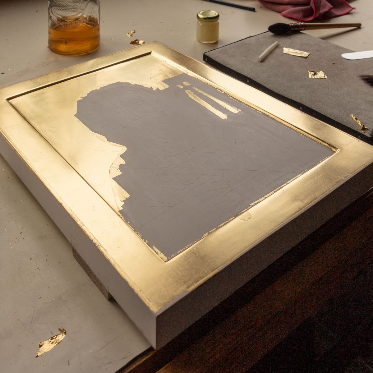 Gilding the icon of Saint Cyril.